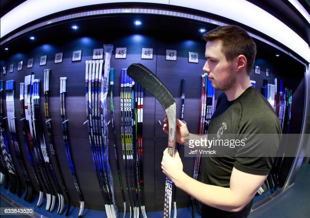 Brendan Gaunce of the Vancouver Canucks picks his game sticks before their NHL game against the Minnesota Wild at Rogers Arena February 4 2017 in...
