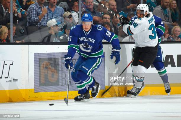 Brendan Gaunce of the Vancouver Canucks skates after the puck against Bracken Kearns of the San Jose Sharks during a preseason NHL game at SAP Center...
