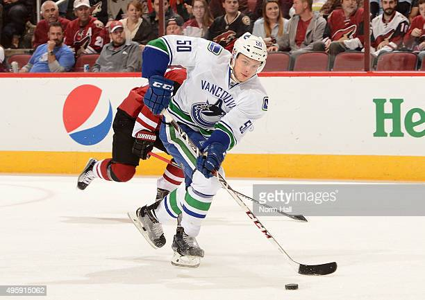 Brendan Gaunce of the Vancouver Canucks skates the puck up ice against the Arizona Coyotes at Gila River Arena on October 30 2015 in Glendale Arizona