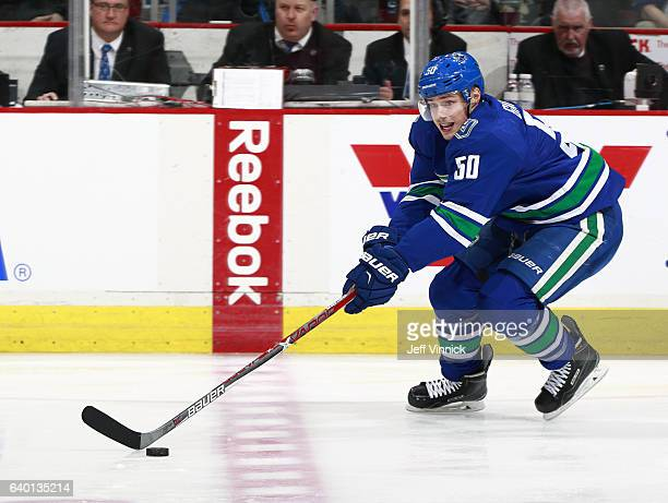 Brendan Gaunce of the Vancouver Canucks skates up ice with the puck during their NHL game against the Florida Panthers at Rogers Arena January 20...