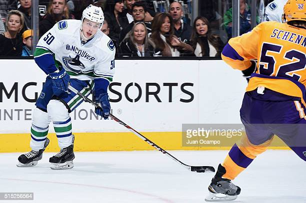 Brendan Gaunce of the Vancouver Canucks skates with the puck against Luke Schenn of the Los Angeles Kings on March 7 2016 at Staples Center in Los...