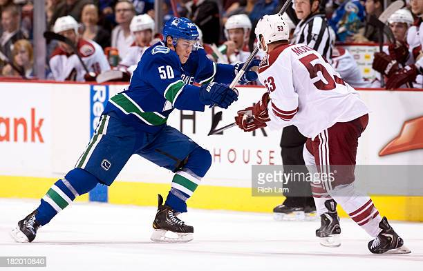 Brendan Gaunce of the Vancouver Canucks tries to get past Derek Morris of the Phoenix Coyotes during NHL preseason action on September 23 2013 at...