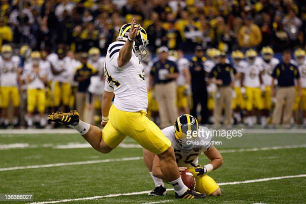 Brendan Gibbons of the Michigan Wolverines kicks a successfu l39yard field goal in the fourth quarter against the Virginia Tech Hokies during the...