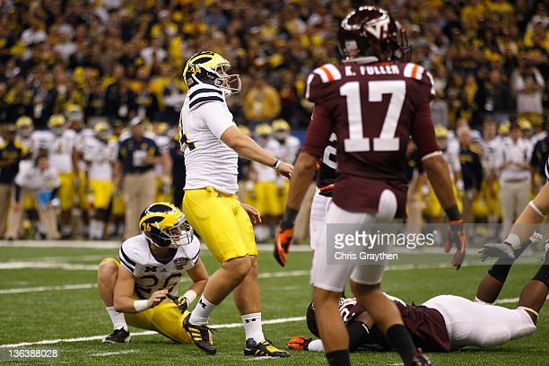 Brendan Gibbons of the Michigan Wolverines watches his successfu l39yard field goal in the fourth quarter against the Virginia Tech Hokies during the...