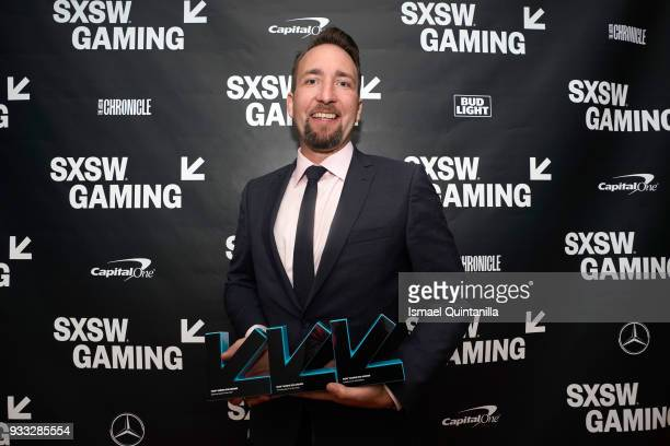 Brendan Greene poses with the awards for Esports Game of the Year Trending Game of the Year and Excellence in Multiplayer backstage at SXSW Gaming...