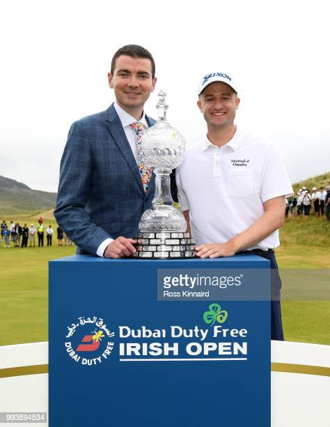 Brendan Griffin Minister of State Tourism and Sport and Russell Knox of Scotland after his playoff win in the final round of the Dubai Duty Free...
