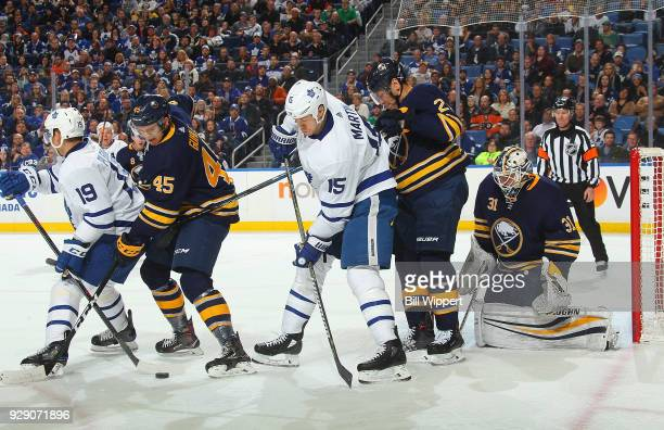 Brendan Guhle Kyle Okposo and Chad Johnson of the Buffalo Sabres defend during an NHL game against Tomas Plekanec and Matt Martin of the Toronto...