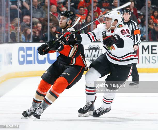Brendan Guhle of the Anaheim Ducks and Carl Dahlstrom of the Chicago Blackhawks watch an airborne puck during the first period of the game at Honda...