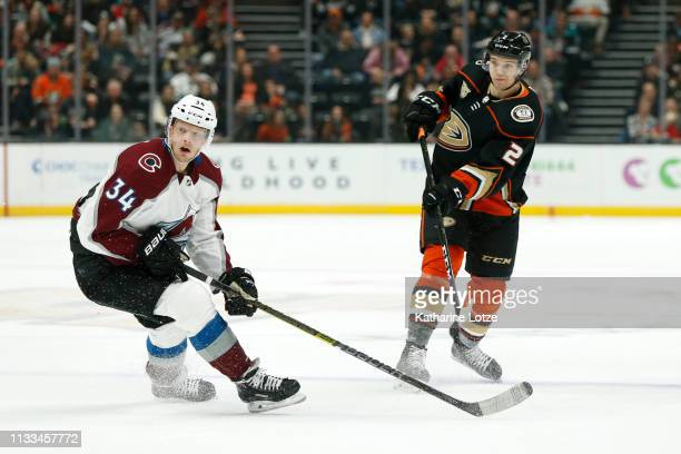 Brendan Guhle of the Anaheim Ducks passes the puck as Carl Soderberg of the Colorado Avalanche looks on during the first period at Honda Center on...