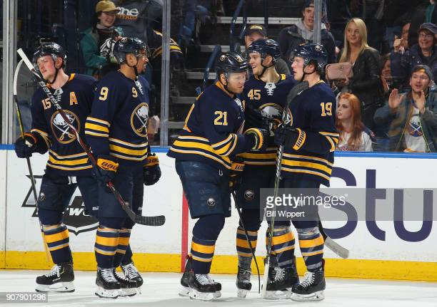 Brendan Guhle of the Buffalo Sabres celebrates his first NHL point during an NHL game against the Columbus Blue Jackets on January 11 2018 at KeyBank...