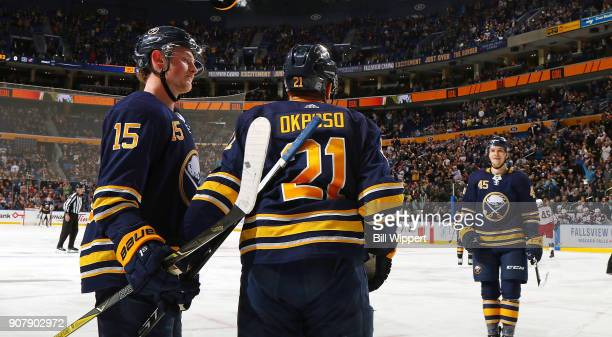 Brendan Guhle of the Buffalo Sabres celebrates his first NHL point with Jack Eichel and Kyle Okposo during an NHL game against the Columbus Blue...