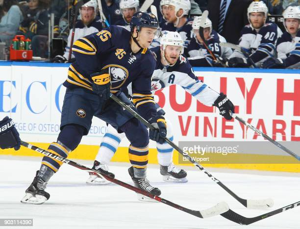 Brendan Guhle of the Buffalo Sabres controls the puck against the Winnipeg Jets during an NHL game on January 9 2018 at KeyBank Center in Buffalo New...