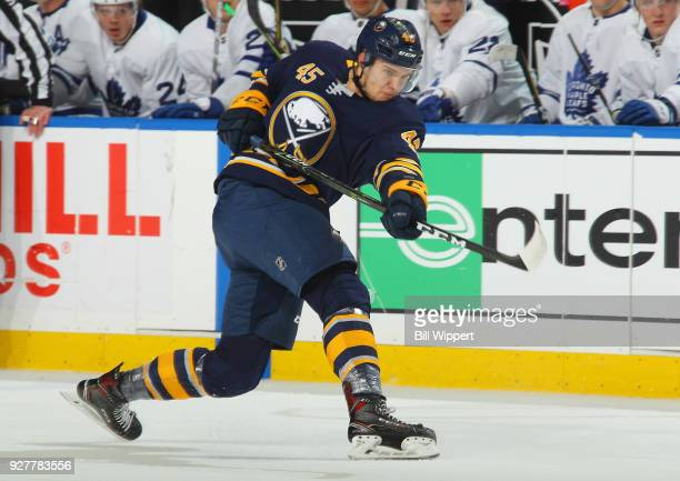 Brendan Guhle of the Buffalo Sabres fires a shot against the Toronto Maple Leafs during an NHL game on March 5 2018 at KeyBank Center in Buffalo New...