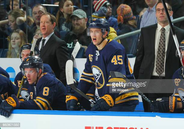 Brendan Guhle of the Buffalo Sabres reacts from the bench during an NHL game against the Calgary Flames on March 7 2018 at KeyBank Center in Buffalo...