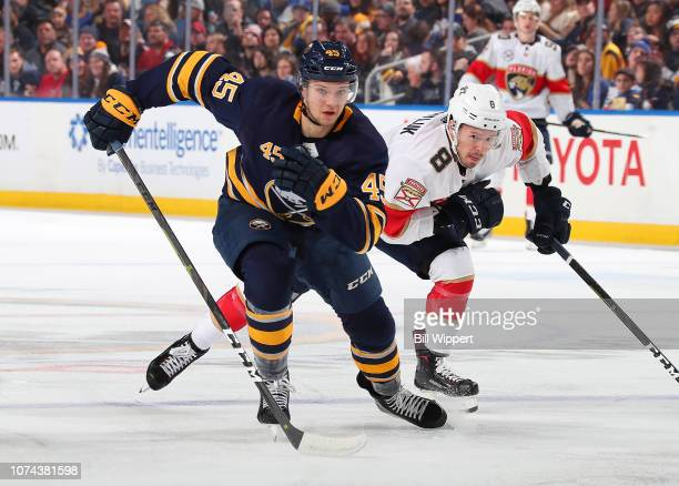 Brendan Guhle of the Buffalo Sabres skates against Jayce Hawryluk of the Florida Panthers during an NHL game on December 18 2018 at KeyBank Center in...