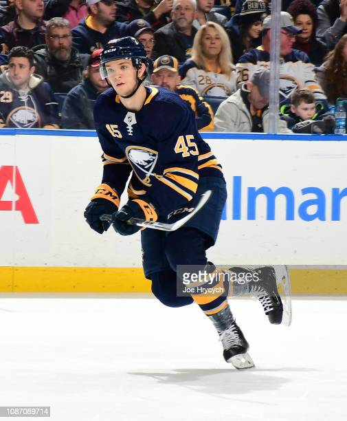 Brendan Guhle of the Buffalo Sabres skates against the Florida Panthers during an NHL game on December 18 2018 at KeyBank Center in Buffalo New York
