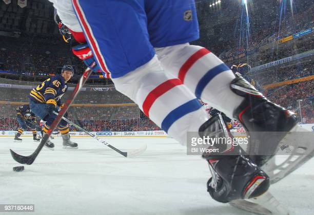 Brendan Guhle of the Buffalo Sabres skates in to defend against the Montreal Canadiens during an NHL game on March 23 2018 at KeyBank Center in...