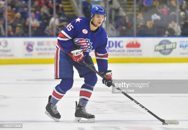 Brendan Guhle of the Rochester Americans brings the puck up ice during a game against the Bridgeport Sound Tigers at the Webster Bank Arena on...