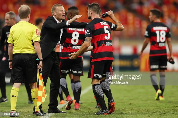 Brendan Hamill of the Wanderers celebrates scoring a goal with Wanderers coach Josep Gombau during the round 22 ALeague match between the Western...