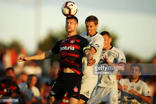 Brendan Hamill of the Wanderers heads the ball during the round four ALeague match between the Western Sydney Wanderers and the Brisbane Roar at Glen...