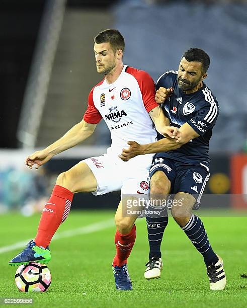 Brendan Hamill of the Wanderers is challenged by Fahid Ben Khalfallah of the Victory during the round six ALeague match between the Melbourne Victory...