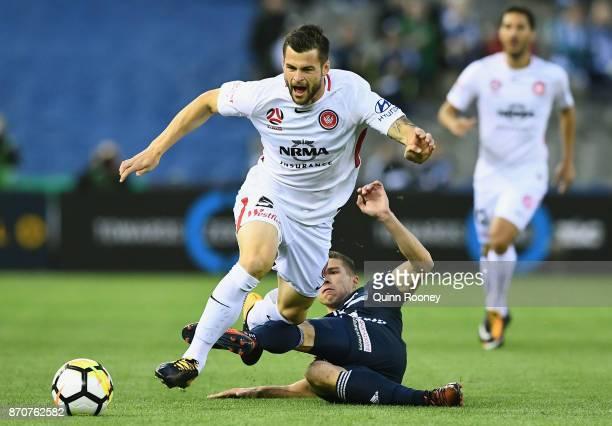 Brendan Hamill of the Wanderers is tackled by Mitchell Austin of the Victory during the round five ALeague match between the Melbourne Victory and...