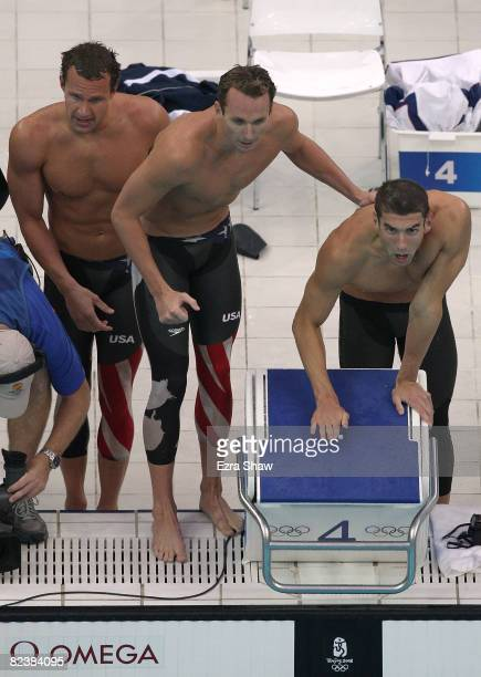 Brendan Hansen Aaron Piersol and Michael Phelps of the United States cheer on teammate Jason Lezak en route to winning the gold medal in the Men's...