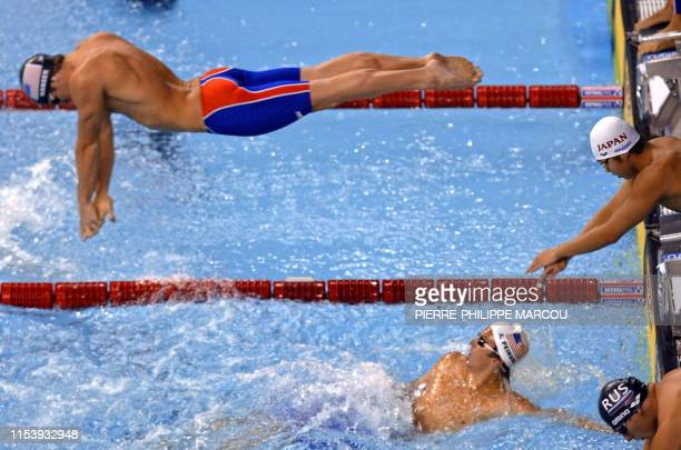 Brendan Hansen dives during the men's 4X100m medley relay final, 27 July 2003 in Barcelona, at the 10th FINA Swimming World Championships. USA won...