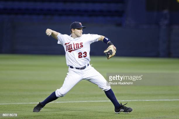 Brendan Harris of the Minnesota Twins throws to first against the Tampa Bay Rays on April 29, 2009 at the Metrodome in Minneapolis, Minnesota. The...