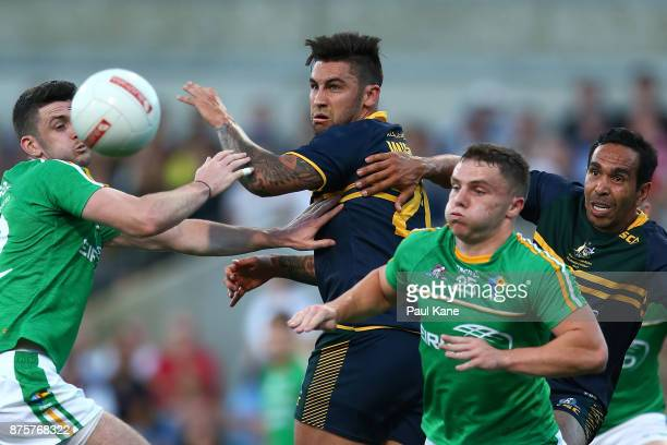Brendan Harrison and Sean Powter of Ireland contest for the ball against Chad Wingard and Eddie Betts of Australia during game two of the...