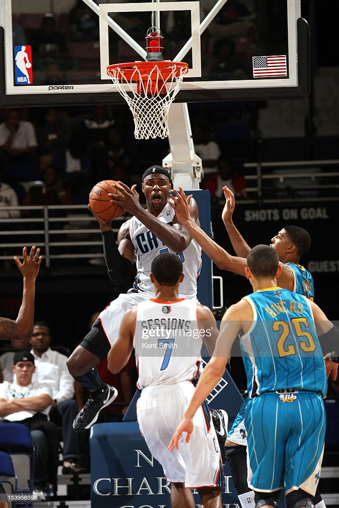 Brendan Haywood #33 of the Charlotte Bobcats looks to pass to teammate Ramon Sessions against the New Orleans Hornets at the North Charleston Coliseum on October 11, 2012 in North Charleston, South Carolina.