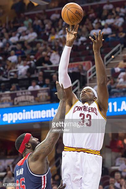 Brendan Haywood of the Cleveland Cavaliers shoots over DeJuan Blair of the Washington Wizards during the second half at Quicken Loans Arena on April...