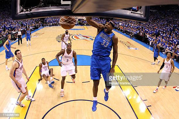 Brendan Haywood of the Dallas Mavericks dunks the ball in the first half while taking on the Oklahoma City Thunder in Game Three of the Western...