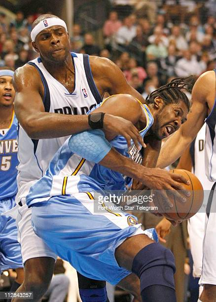 Brendan Haywood of the Dallas Mavericks guards Nene of the Denver Nuggets at the American Airlines Center in Dallas Texas Monday March 29 2010