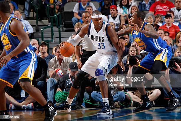 Brendan Haywood of the Dallas Mavericks posts up against Mickell Gladness of the Golden State Warriors on April 20, 2012 at the American Airlines...