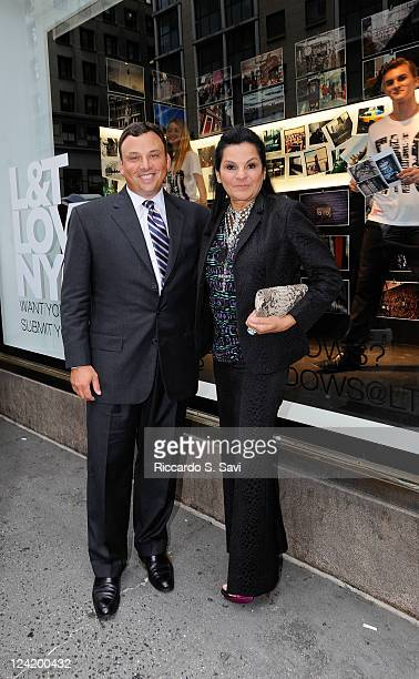 Brendan Hoffman and Candy Pratts Price attend Fashion Night Out at Lord Taylor on September 8 2011 in New York City