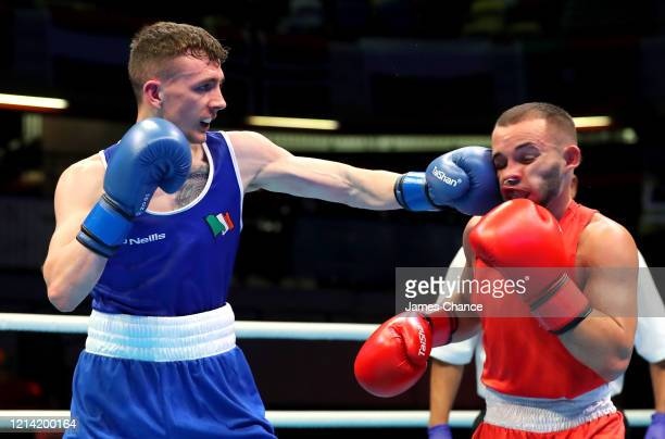 Brendan Irvine of Ireland punches Istvan Szaka of Hungary in their Men's Fly Preliminary round bout on Day Three of the Road to Tokyo European Boxing...