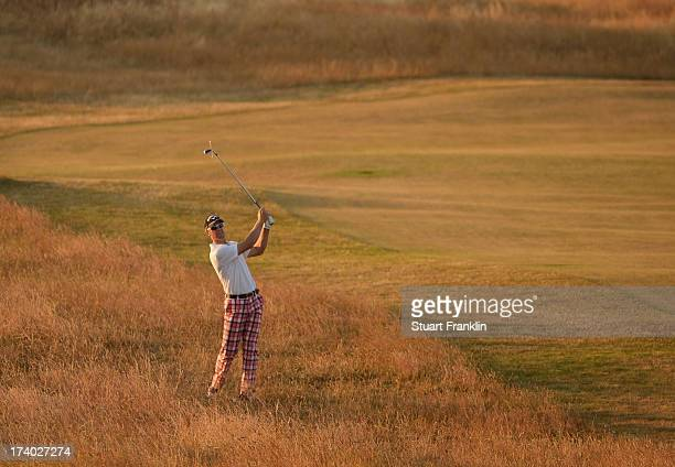 Brendan Jones of Australia hits a shot on the 18th during the second round of the 142nd Open Championship at Muirfield on July 19 2013 in Gullane...