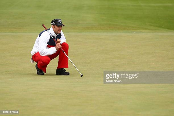 Brendan Jones of Australia lines up a putt during round four of the 2012 Australian Open at The Lakes Golf Club on December 9 2012 in Sydney Australia
