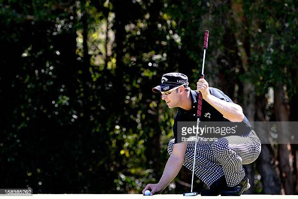 Brendan Jones of Australia lines up a putt on the 16th hole during round three of the Australian PGA Championship at the Palmer Coolum Resort on...
