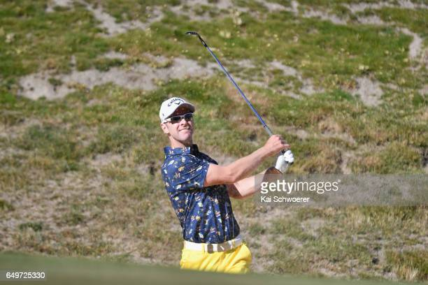 Brendan Jones of Australia plays a bunker shot during day one of the New Zealand Open at The Hills on March 9 2017 in Queenstown New Zealand