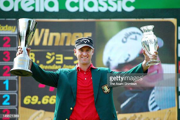 Brendan Jones of Australia poses for photographs after winning the Sun Chlorella Classic at Otaru Country Club on July 29 2012 in Otaru Hokkaido Japan