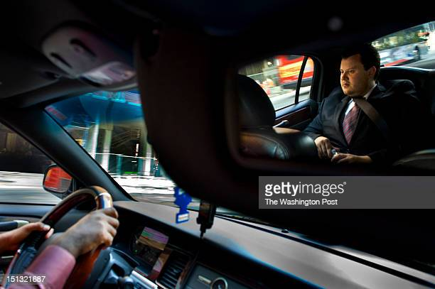Brendan Kownacki rides in the UBER Car that he beckon via a smartphone app in Washington DC on July 16 2012 He pays a little more than cabs but says...