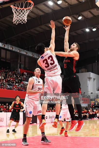 Brendan Lane of the Alvark Tokyo shoots while under pressure from Takumi Hasegawa of the Kawasaki Brave Thunders during the BLeague match between...
