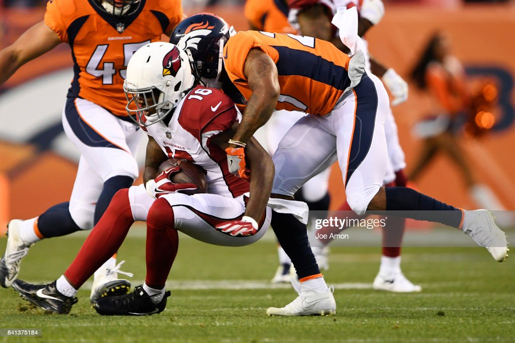 Brendan Langley (27) of the Denver Broncos brings down Chad Williams (16) of the Arizona Cardinals during the first quarter of action. The Denver Broncos hosted the Arizona Cardinals at Sports Authority Field at Mile High in Denver, Colorado on August 31, 2017.