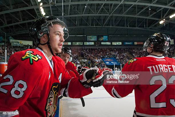 Brendan Leipsic and Dominic Turgeon of the Portland Winterhawks celebrate a goal against the Kelowna Rockets on April 25 2014 during Game 5 of the...