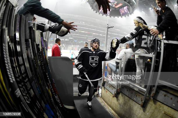 Brendan Leipsic of the Los Angeles Kings and fans highfive as he leaves the ice after warmup before his Kings debut in the game against the Arizona...