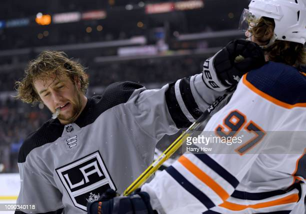 Brendan Leipsic of the Los Angeles Kings pushes Connor McDavid of the Edmonton Oilers during the third period in a 40 Kings win at Staples Center on...