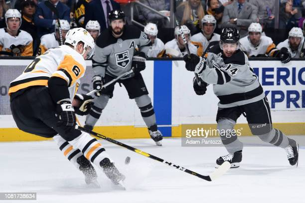 Brendan Leipsic of the Los Angeles Kings shoots the puck with pressure from Jamie Oleksiak of the Pittsburgh Penguins during the third period of the...