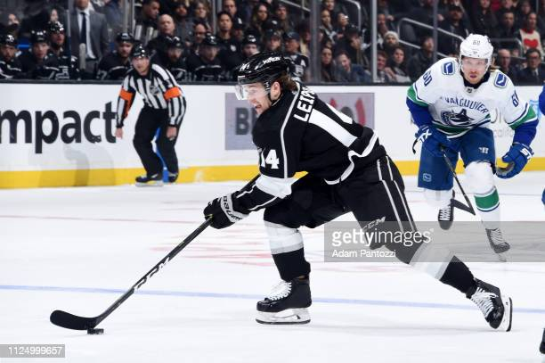 Brendan Leipsic of the Los Angeles Kings skates with the puck while pursued by Markus Granlund of the Vancouver Canucks during the third period of...
